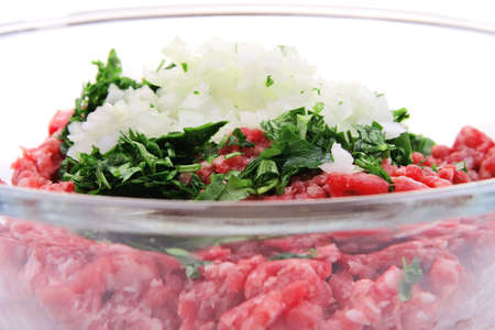 minced meat inside big transparent bowl side view photo