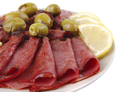 sliced served sausage with green olives and raw lemon Stock Photo - 4985358