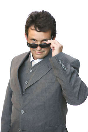 man in suit with sunglasses over white background  photo