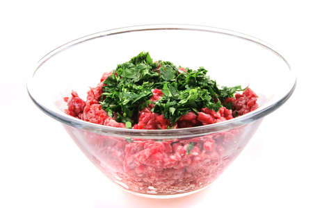 mince meet inside transparent bowl over white photo