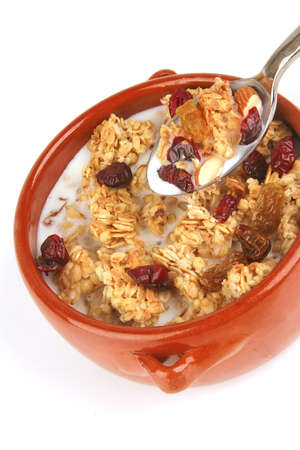 pot full of granola with nuts and drain berry photo
