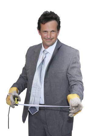 journeyman: businessman with measure tool over white backgroudn