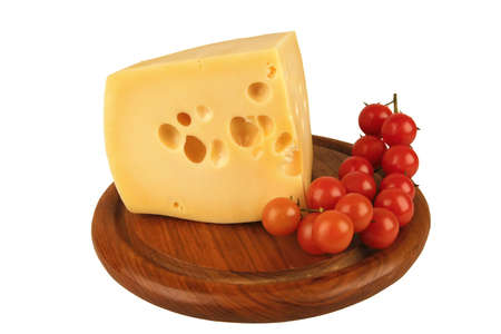big chunk of yellow cheese and cherry tomatoes photo