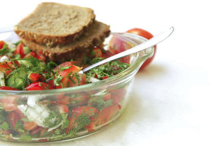 tomato salad on white table with rye bread photo