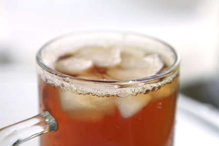 apple juice inside big glass on white table photo