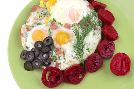 fried eggs and red eggplant on green dish photo