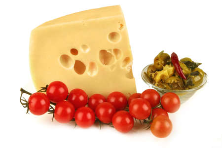 big chunk of yellow cheese with gold olives and tomatoes Stock Photo - 5123797