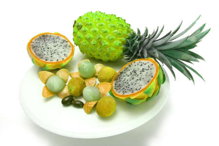 exotic tropical fruits isolated over white photo