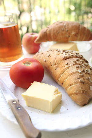 french breakfast with apple juice and tomato photo