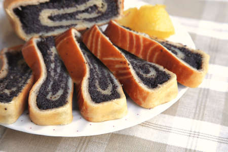 poppy pie served on dish with lemon photo