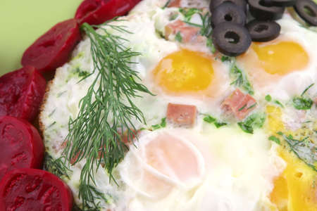 fried eggs and red eggplant on green dish Stock Photo - 5154910