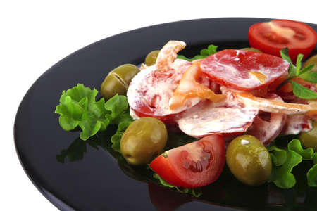 tomatoes salad and olives on black dish photo