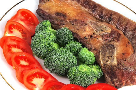 roast steak with bone-in and vegetables photo