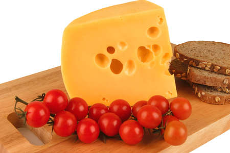 big yellow cheese with tomato and bread photo