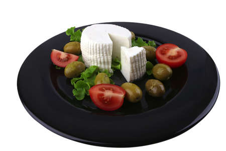soft feta cheese served with tomato and olives photo