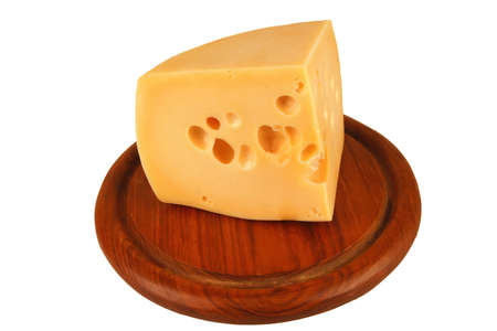 big chunk of yellow cheese on wood cheeseboard photo