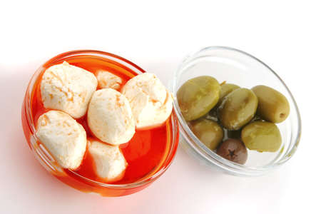 spiced: mozzarella cheese spiced served over white background Stock Photo