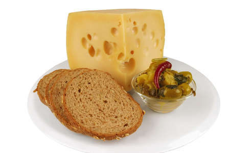 yellow cheese with olives and bread on white dish photo