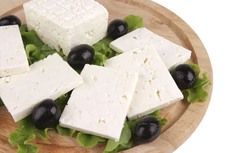 ready to cook food: feta cheese on wooden plate with salad