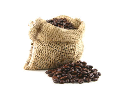 coffee bag full of beans over white background Stock Photo