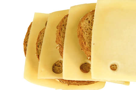 cheese slices on rye bread over white background photo