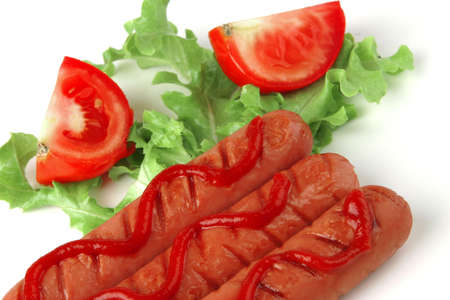 fresh grilled sausages served with tomato and ketchup photo