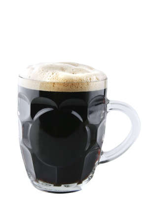 dark beer in big glass isolated over white photo