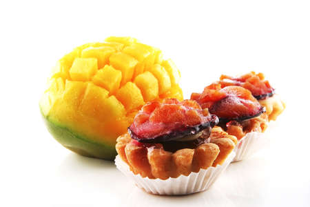 uncooked mango and small fruit cakes served Stock Photo - 5344436