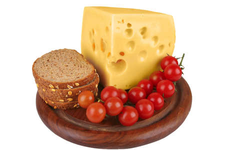 big chunk of yellow cheese with cherry tomatoes and bread photo