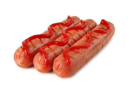 row of sausages with ketchup over white photo