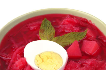 fresh beet vegetable soup in green bowl photo
