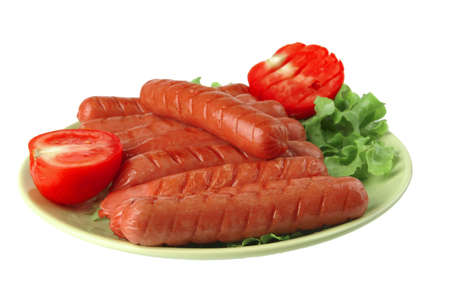 grilled sausages served on green dish wtih tomato Stock Photo - 5411400