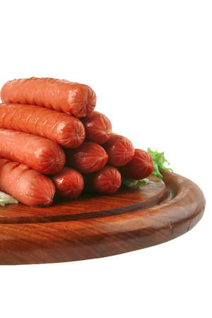 beef grilled sausages served on plate with vegetables photo
