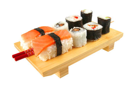 maki and sashimi sushi on wooden plate with sticks