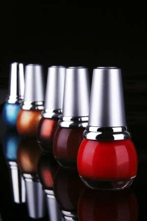 many new nails polish on black background