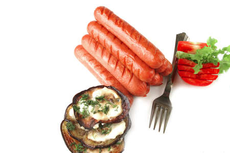 sausages served on white background with vegetables photo
