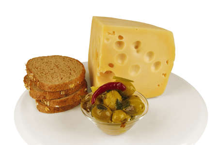 yellow cheese with olives and bread on white dish Stock Photo - 5461668