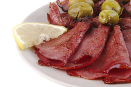 sliced served sausage with green olives and raw lemon Stock Photo - 5461643