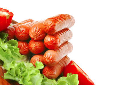 grilled sausages served on wooden plate with vegetables Stock Photo - 6013801