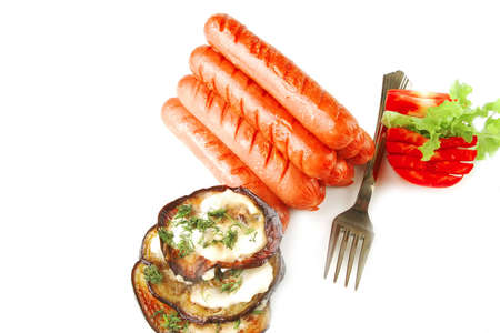 sausages served on white background with vegetables Stock Photo - 6013789