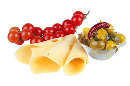 slices of yellow cheese with olives and tomatoes on dish photo