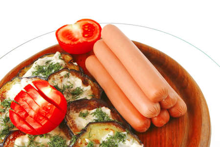 fresh sausages on plate with grilled eggplant photo