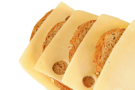 cheese slices on rye bread over white background Stock Photo - 6124081