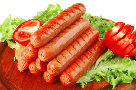 veal sausage: served grilled beef red sausages on wooden plate