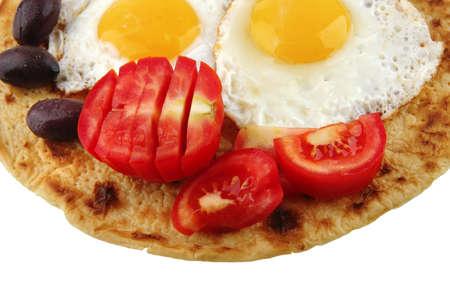 fried eggs on pancake over white background photo