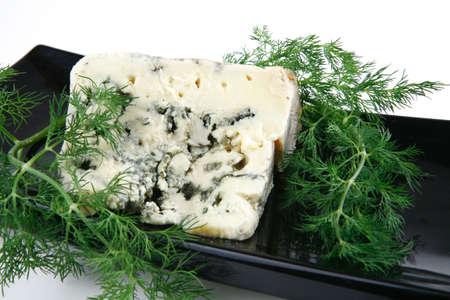 stilton: french stilton soft cheese on black plate Stock Photo