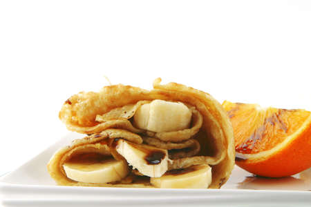 two fried pancakes on white porcelan dish photo