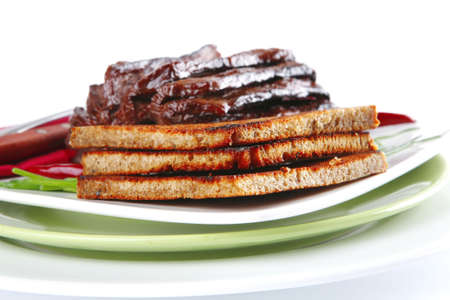 notched: served notched meat with eggplant on white