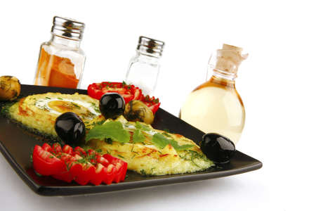 mash served on black dish with spices photo