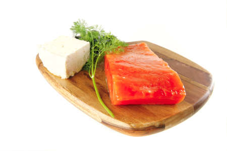 smoked salmon chunk with olives and white cheese photo
